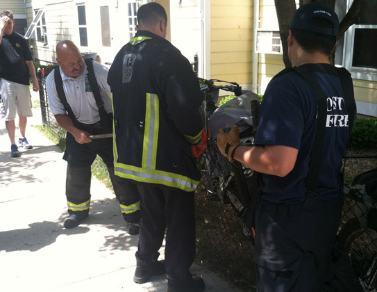 Firefighters cutting bolts on dirt bikes at Mission Main project