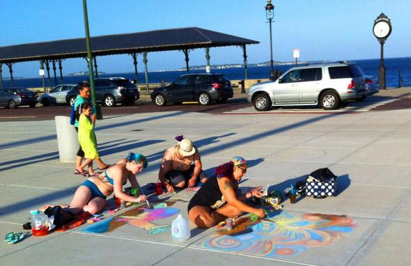 People using sidewalk chalk at Wonderland