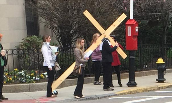 Man with a cross on Longwood Avenue