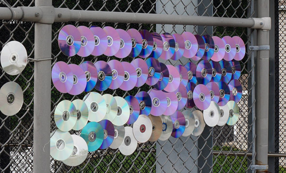 CDs on a fence at the Fairmount commuter-rail station in Hyde Park