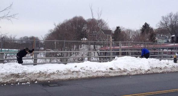 Shoveling out the Fairmount Avenue bridge in Hyde Park