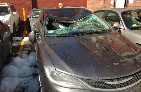 One car destroyed, one damaged by falling ice bombs
