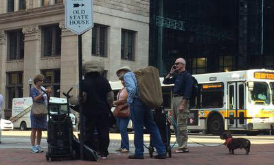 Musician tries to muscle Keytar Bear off downtown corner