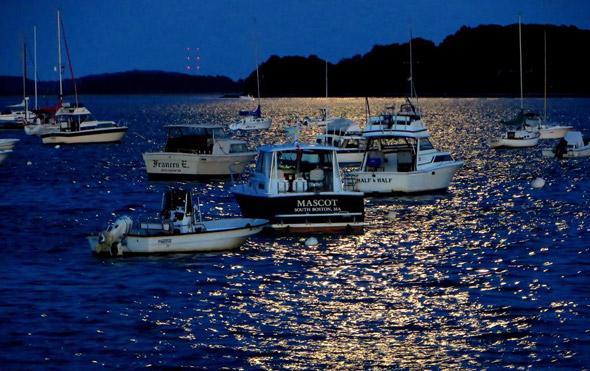 Boats off South Boston at night