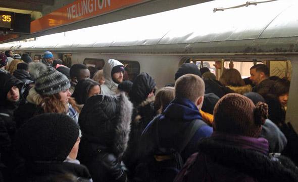 Packed platform on the Orange Line at Wellington