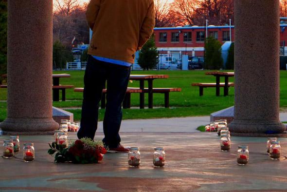 Man waits for girlfriend at Carson Beach in South Boston