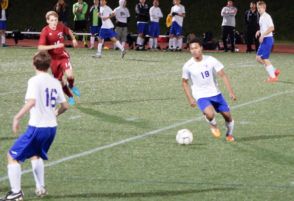 Roger Cawdette sets up for Boston Latin School in soccer match.