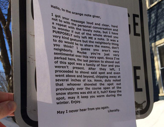 An angry note about a parking space in Inman Square in Cambridge.