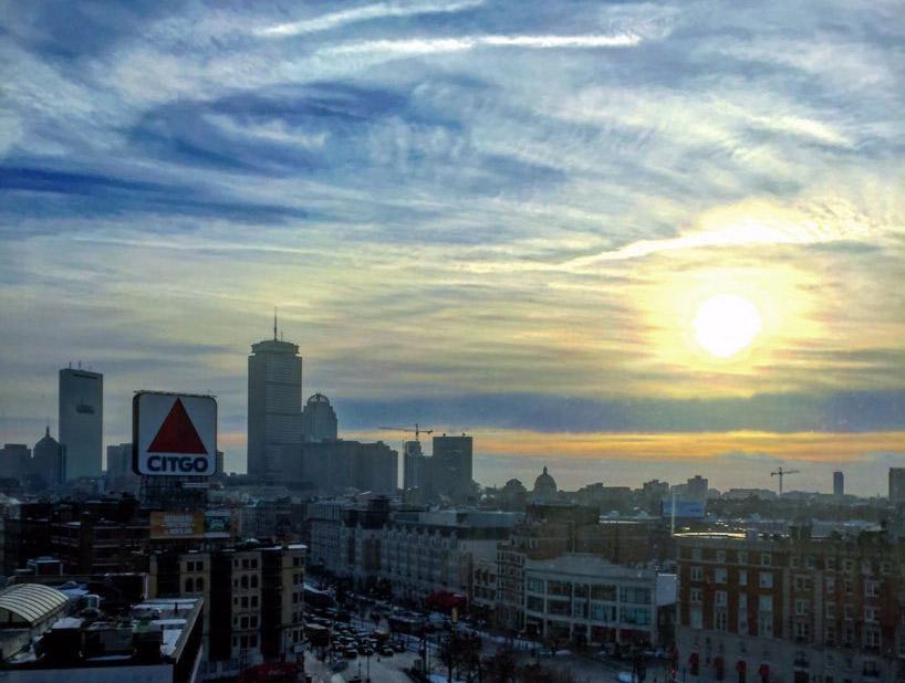 Sun rising over the Citgo sign and Kenmore Square in Boston