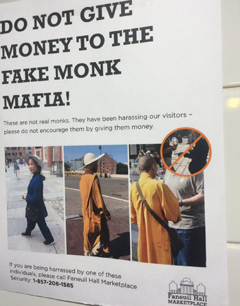 Sign at Faneuil Hall warning against fake monks