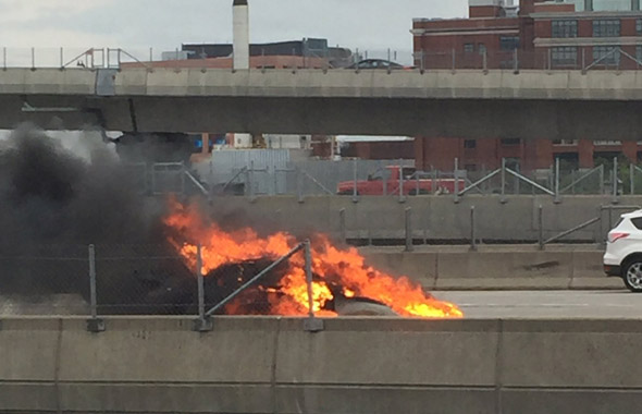 Car in flames on I-93 in Boston