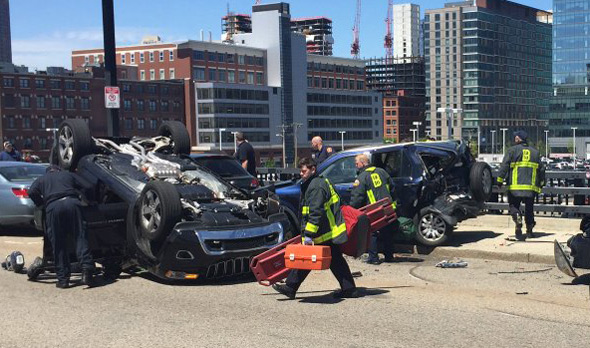 Flipped SUV on Summer Street in South Boston