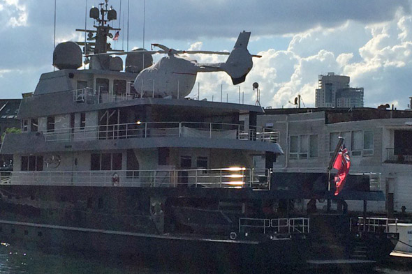 Helicopter on a boatd docked by Long Wharf in Boston