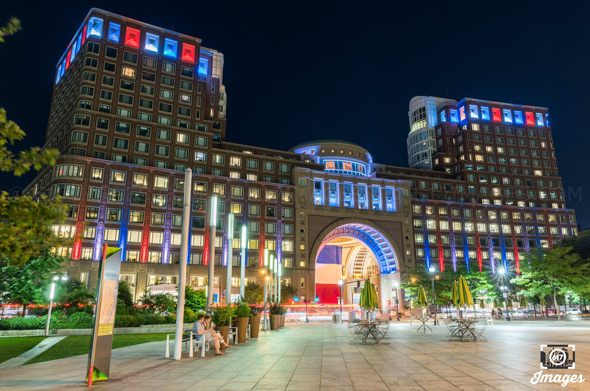 Rowes Wharf lit up in support of France