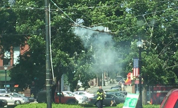 Burning trackless-trolley wires in Watertown Square