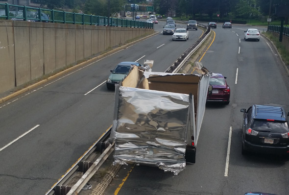 Peeled back truck on Soldiers Field Road