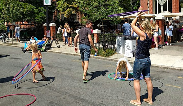Hula hooping on Newbury Street in the Back Bay
