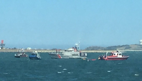 Kayakers being rescued in Dorchester Bay