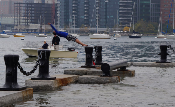 Guy diving into Boston Harbor during king tide