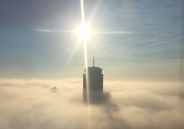 Prudential building rises above the fog in Boston