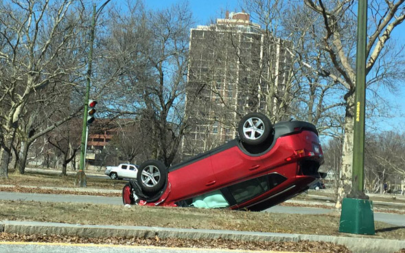 Red car flipped on Soldiers Field Drive in Brighton