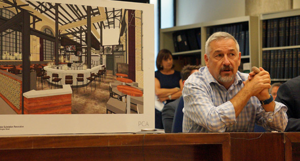 Chris Douglass with plans for proposed Roslindale restaurant