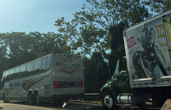 A bus and a truck stuck on Storrow Drive
