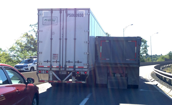 Two trucks stuck on ramp to I-495