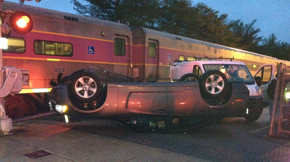 Turtle car hit by train in Needham