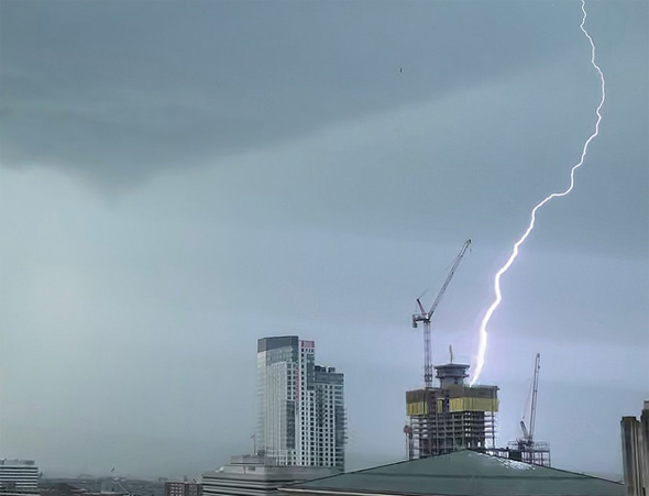Lightning hits a building under construction in Boston