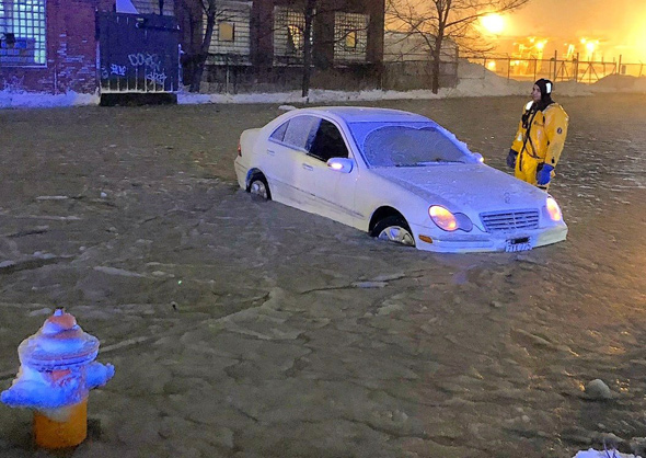 Flooded car in Chelsea