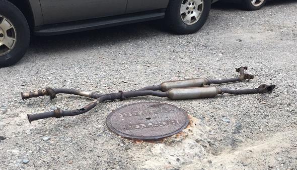 Exhaust pipes on Ada Street in Roslindale