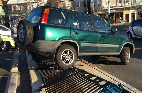 Subaru pushed down fence at the Jamaica Plain Whole Foods
