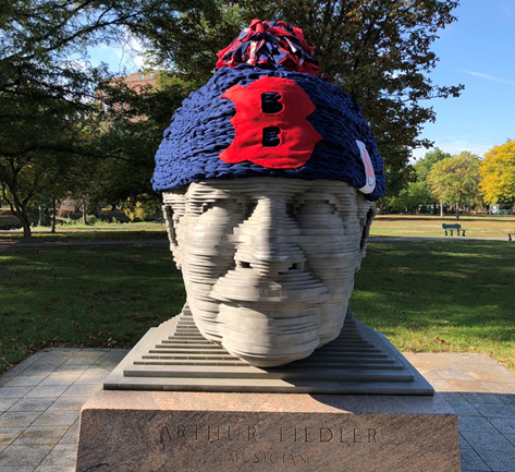 Arthur Fiedler's giant head with a Red Sox cap on