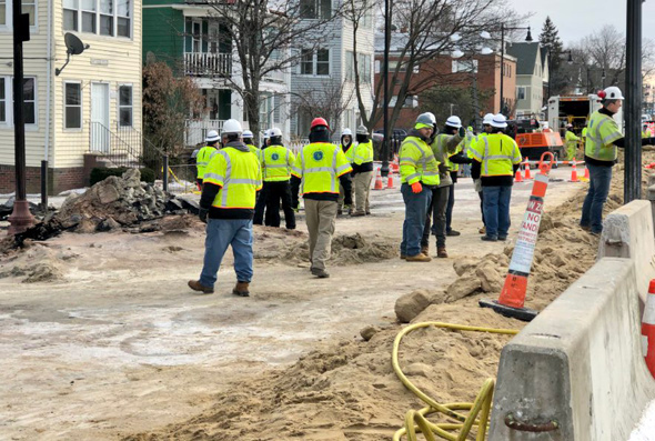 Workers on Hyde Park Avenue at gas-main flame