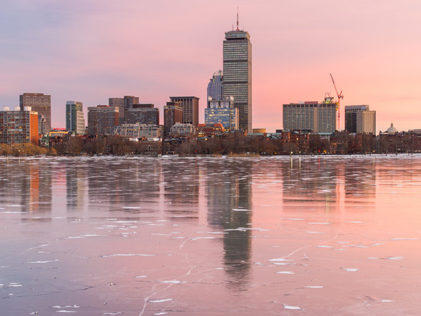 Boston skyline at sunset with ice on the Charles