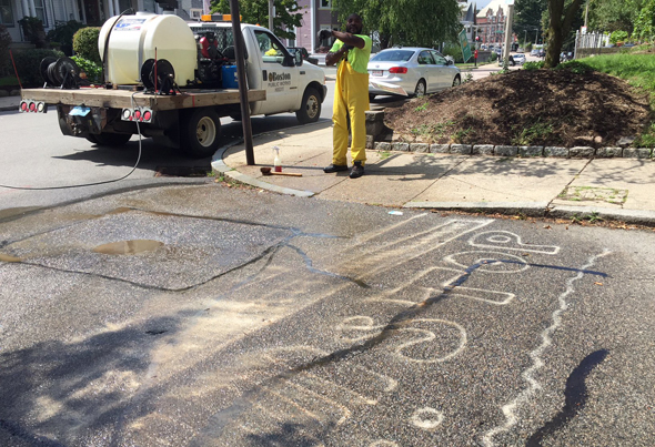 Power washing guerilla crosswalk in Roslindale