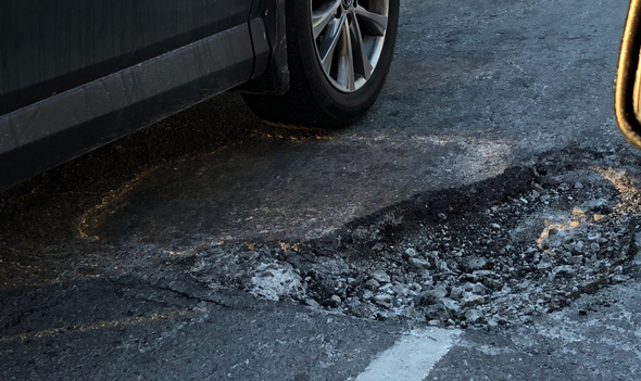 Pothole at the Jamaicaway and Perkins Street in Jamaica Plain