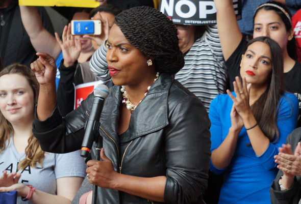 Pressley speaks as AOC, others listen