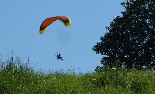 Paraglider with propeller at Millennium Park in West Roxbury
