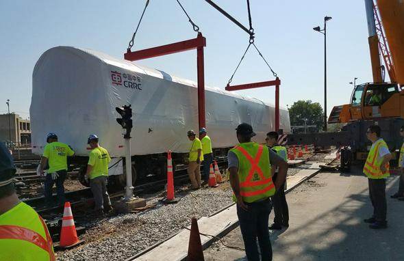 New Orange Line car being unloaded at Wellington yard