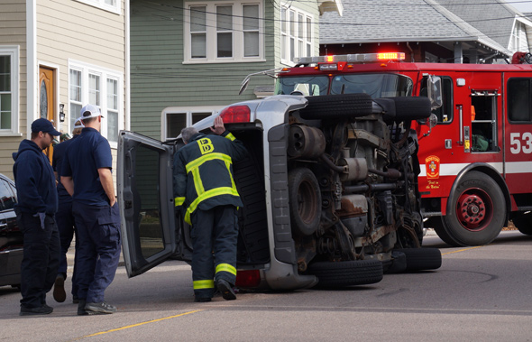Partially flipped SUV in Roslindale