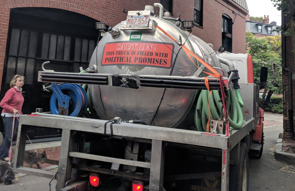 Truck filled with politicians' promises on Beacon Hill