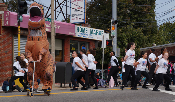 Dinosaur and dancers in Roslindale Day Parade