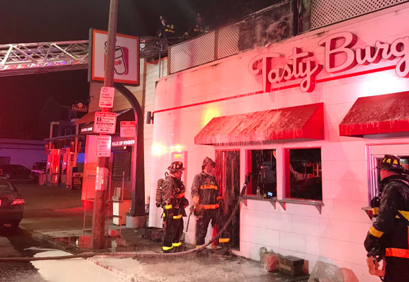 Firefighters at South Boston Tasty Burger after fire