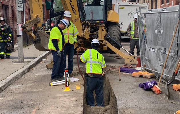 Workers fixing gas leak outside 1065 Tremont St.