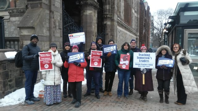 Teachers stood outside before school today in Copley Square to bring attention to the fact that they have been working without a contract since the beginning of this school year.
