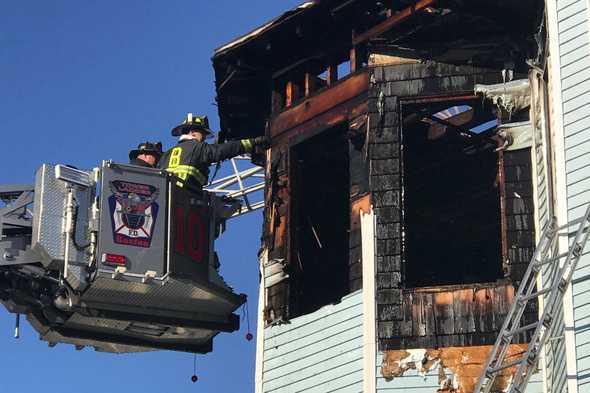 Firefighters inspect 688 Columbia Rd, in Dorchester after fire is knocked down