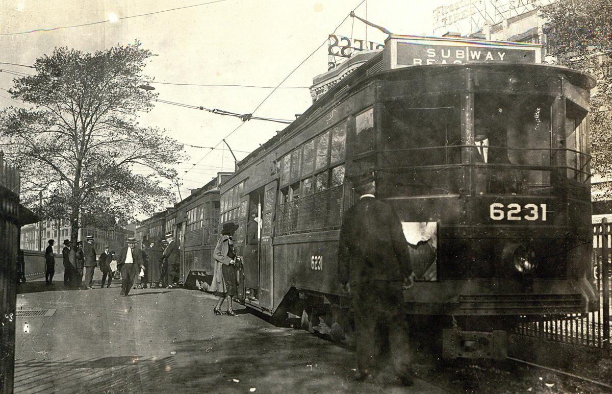 People boarding a streetcar in old Boston