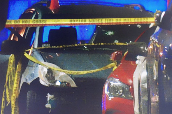 Suspect's car, with bullet holes